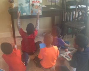 Birdy Book Club members show Brian via FaceTime one of their favorite pictures from his book.